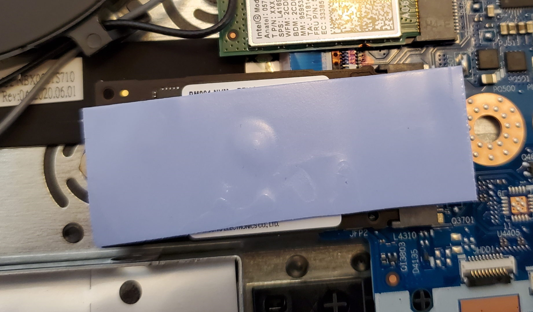 photo of the m.2 ssd with the thermal pad still on it